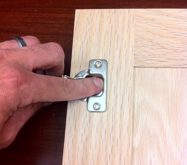 press the hinge into the hole