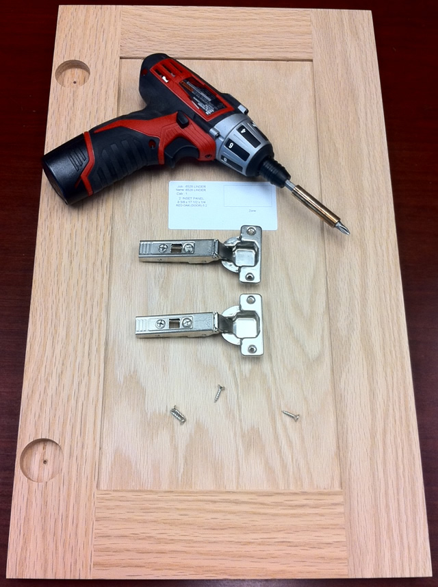 ready your hinges screws and cabinet doors