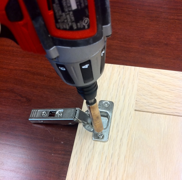 attach teh hinge to the cabinet doors